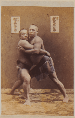 Shimooka Renjō, 'Sumō no torikumi shōbu (wrestlers competing in a sumo bout)'/ 'Wrestlers', c.1867-70. The wrestlers Ayasegawa Sanzaemon (left) and Banjaku Rikikatsu (right) grapple in Shimooka's studio.