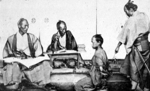 Felice Beato, 'Japanese prisoner & police examiner', albumen print photograph, c.1866