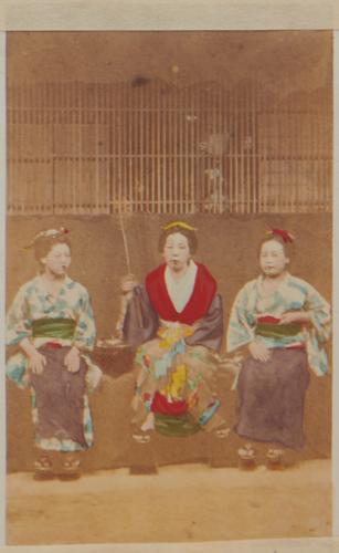 Shimooka Renjō?, 'Ōsaka jorō (Osaka prostitutes )'/ 'Osaka beauties', c.1863-70. Prostitutes pose outside a brothel. A pair of hands can be seen holding the lattice behind them.